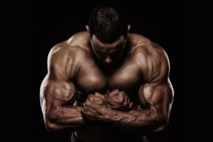 Body builder big lean muscular arms and shoulders